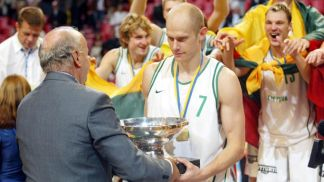 Lithuanian captain Saulius Stombergas receives the European Championship trophy from FIBA Europe President George Vassilakopoulos